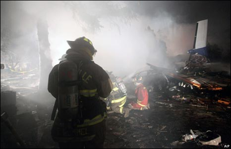 Firefighter at scene of crash in Clarence Center, New York, on 13/2/09