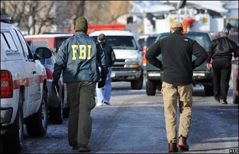 Accident investigators walk to the scene in Clarence Center, New York, on 13/2/09