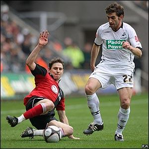 Fulham's Zoltan Gera challenges Angel Rangel