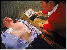 Man being treated with defibrillator
