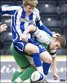 Willie Gibson and Darren McCormack tussle at Rugby Park