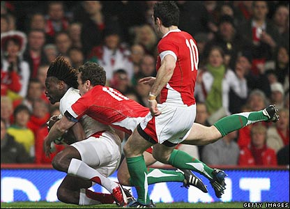 England's Paul Sackey gathers to score the opening try of the match
