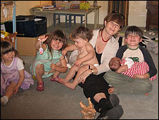 Emma Quinton with five of her children (left to right) Kitty, Poppy, Clara and Sam holding Ronnie