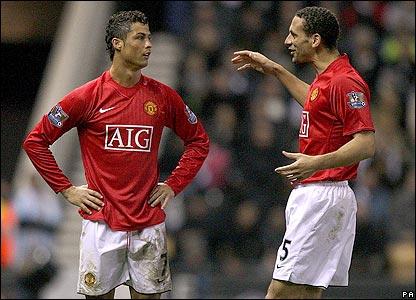Cristiano Ronaldo celebrates scoring United's third goal with Rio Ferdinand