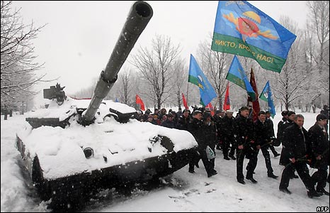 Russian veterans march past a tank during a commemoration rally on Polonnaya hill in Moscow