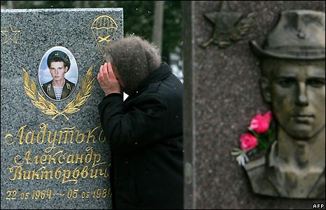 A mother mourns her son at his gravestone in a cemetery outside Minsk, Belarus.