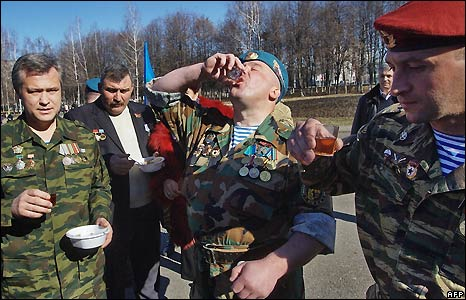 Veterans of the Afghan war make a toast with vodka in Vladikavkaz, in North Ossetia