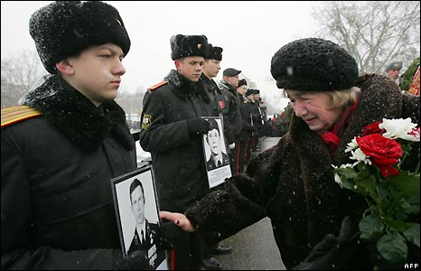 Cadets hold photos of Soviet soldiers killed in Afghanistan during a memorial service in Minsk, Belarus