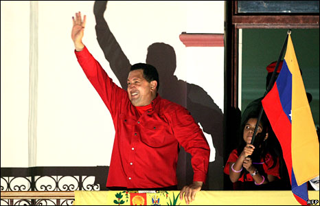Hugo Chavez celebrates his referendum victory on the balcony of the presidential palace, 15 February 2009