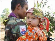 Karen National Union soldier holds child, Karen state, March 2007