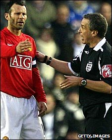 manchester United's Ryan Giggs and referee Alan Wiley