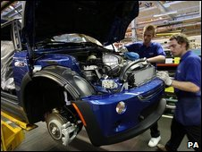 Workers at the mini car production line at the Cowley plant in Oxford.