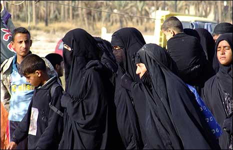 A group of women wearing black