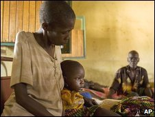 Grandmother sits with three-year-old child attacked by LRA rebels