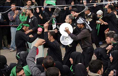 Musicians in the crowd in Karbala