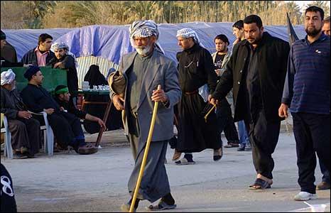 Elderly man walks with stick
