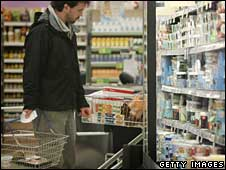 Shopper in supermarket with basket