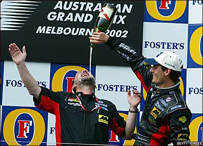 Paul Stoddart (left) and Mark Webber celebrate fifth at the 2002 Australian GP
