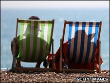 A couple sitting in deck chairs (Image: Getty Images)