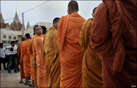 Buddhist monks line up as they arrive at the Extraordinary Chamber in the Courts of Cambodia (ECCC) in Phnom Penh
