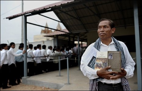 Moeung Sonn, a Cambodian survivor of the Khmer Rouge, outside the courts