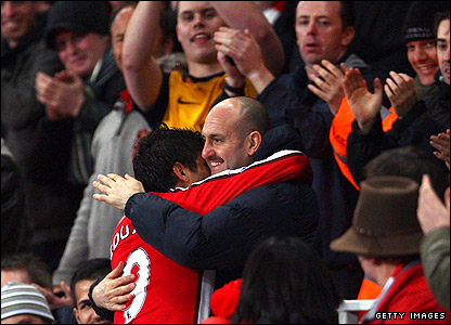 Eduardo hugs Tony Colbert