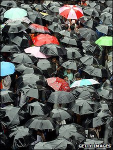 People using umbrellas (Getty Images)