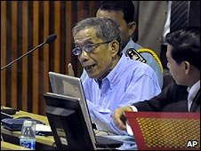 Kaing Guek Eav, also know as Duch (left) looks on during the first day of a UN-backed tribunal in Phnom Penh, Cambodia, 17 February 2009