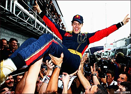 Sebastian Vettel celebrates victory at the Italian Grand Prix in 2008