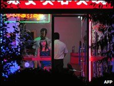 Neon-lit barbarshop offering sexual services, Beijing, China, July 2008