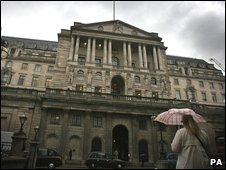 Woman standing before the Bank of England building