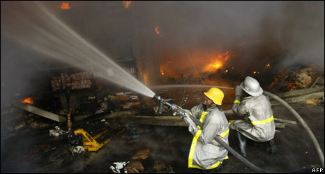 Firefighters at UN warehouse after compound was hit (15.01.09)
