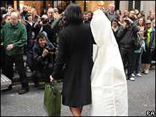 Woman leaving Harrods with Goody's wedding dress