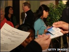 Job seekers and recruiters mingle at a party designed to exchange details in Beverly Hills, California