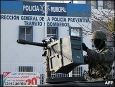 Soldier guards a local police station in Cancun - file photo 9 February