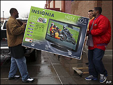 HDTV set being carried out of a shop