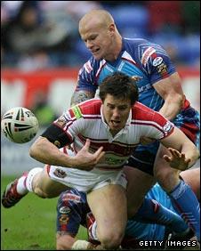 Damien Blanch tackles Wigan's Joel Tomkins