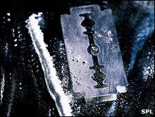 Line of cocaine and a razor blade