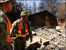 Officials assess the damage at a property in the Marysville region (Image released 14 Feb)