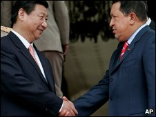 Chinese Vice President Xi Jinping (left) shakes hands with Venezuelan President Hugo Chavez