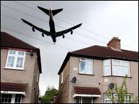 Aeroplane flying over houses