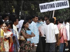 Candidates seeking employment look on during a job fair in India