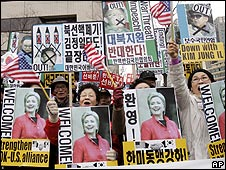 South Korean protesters shout anti-North Korea slogans at a rally welcoming US Secretary of State Hillary Clinton