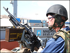 A gun is manned on board HMS Northumberland