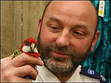 The parakeet with Derek Hampson of the RSPCA