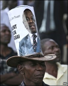 A man with a Tsvangirai poster on his hat