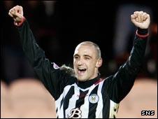 Billy Mehmet celebrates his winner