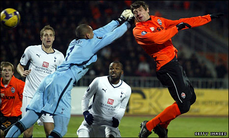 Yevgen Seleznov heads the opener as Dawson (left) can only look on