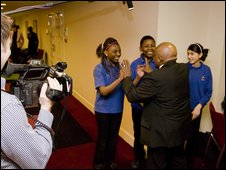 School Reporters 'high five' Archbishop Desmond Tutu