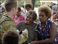 A RAMSI officer talks to locals (Copyright: RAMSI)